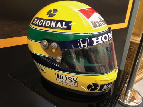 A race-worn Ayrton Senna helmet awaits a bidder