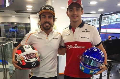 The departing ace and the rising star swap helmets