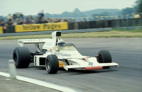 Revson survives first-lap chaos to win maiden GP